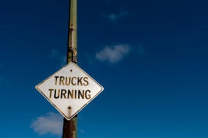 Wide Turn Trucks Caution Sign