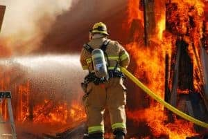 Firefighter putting out an explosion which caused major injuries.