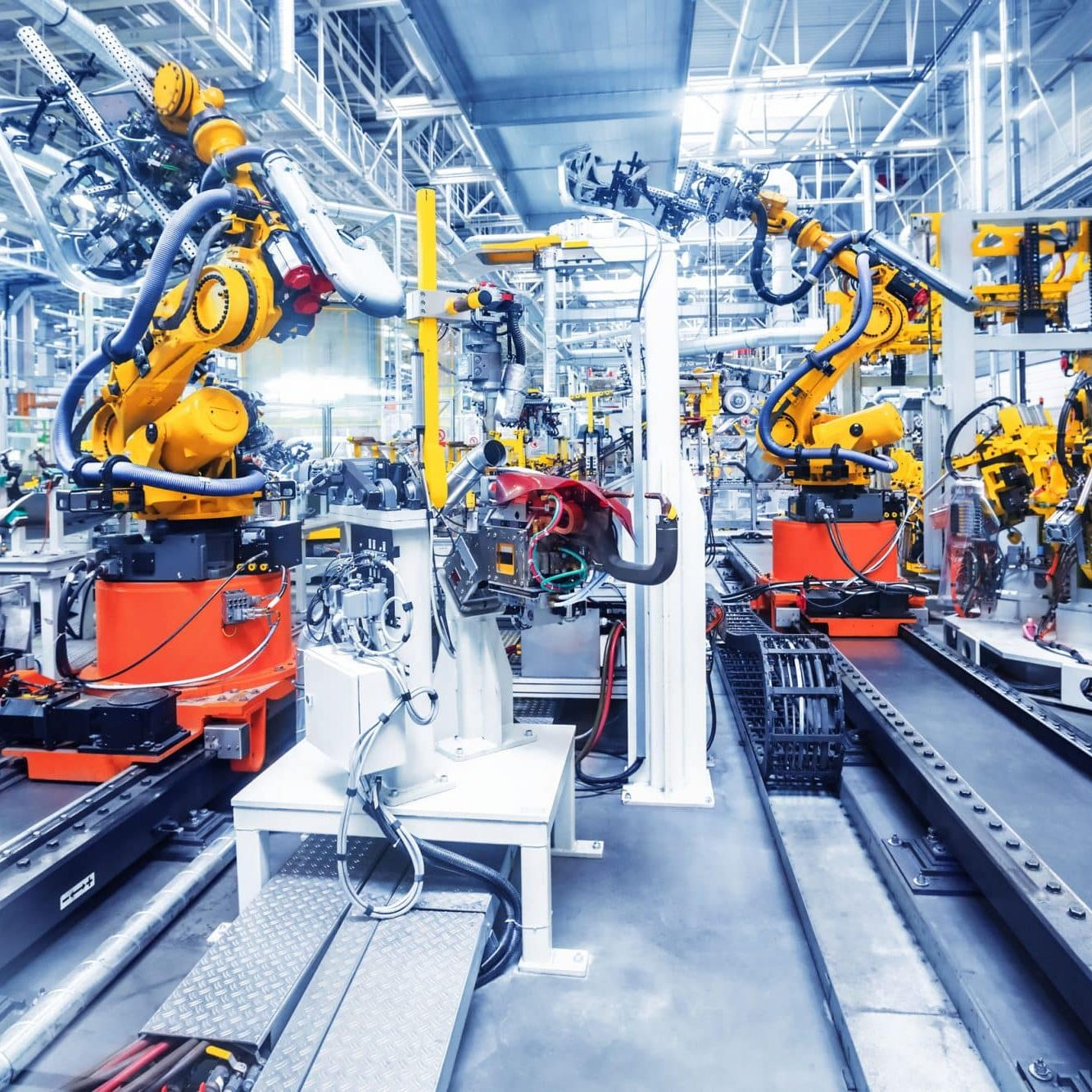 Pictured is an auto plant factory with robotic arms that could potentially cause a defect
