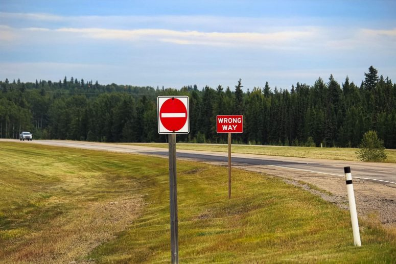 A Do Not Enter and Wrong Way sign on a highway.
