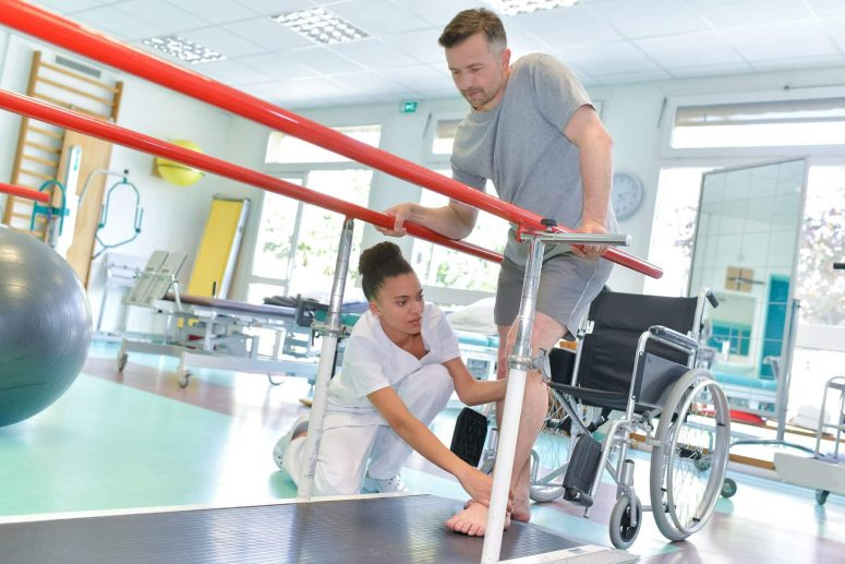 Man receiving physiotherapy after sustataining injuries in a car crash