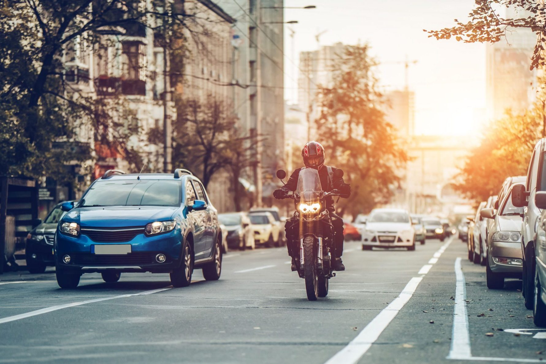 Motorcycle and cars on street