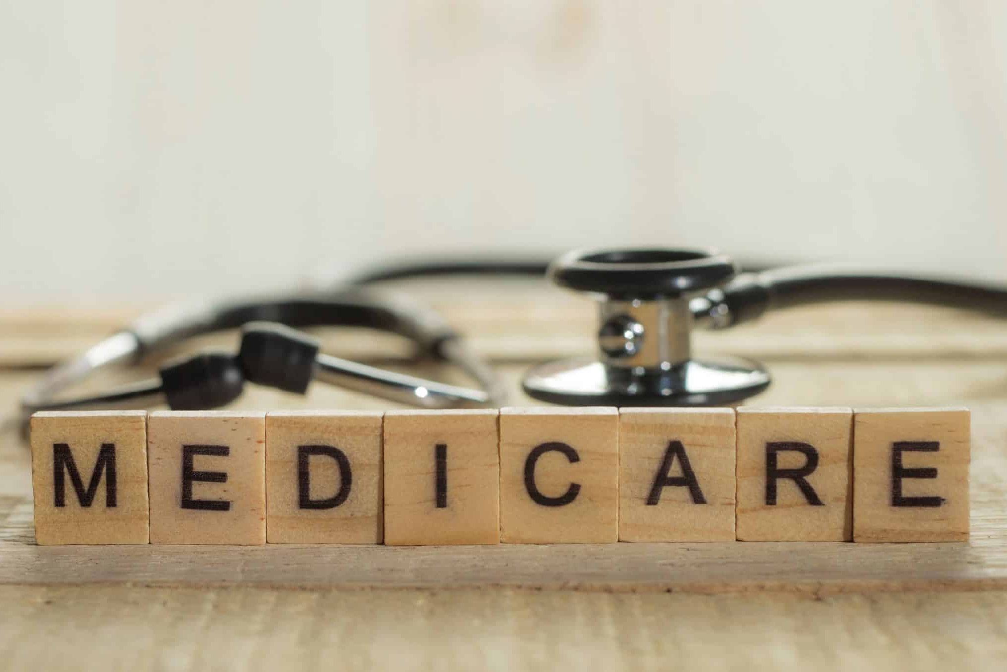 A sign of medicare written in wooden blocks