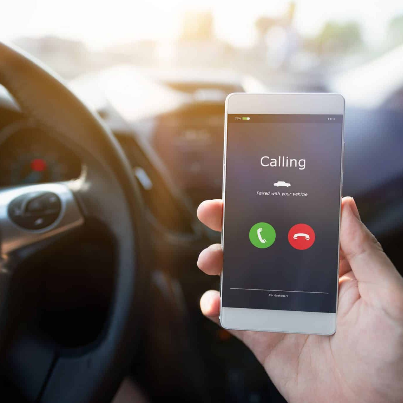 Man using phone calling system in car
