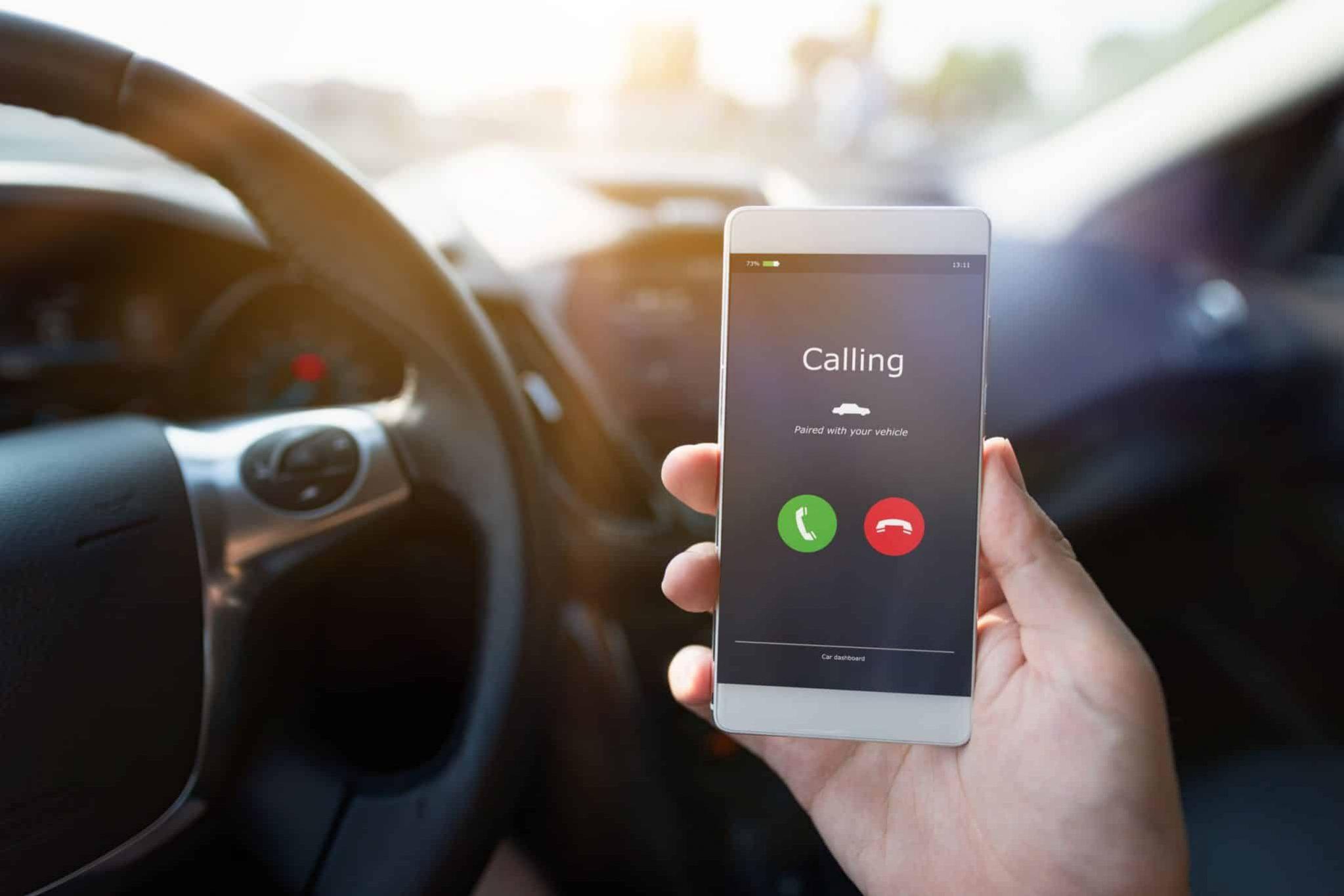 Man using phone calling system in car