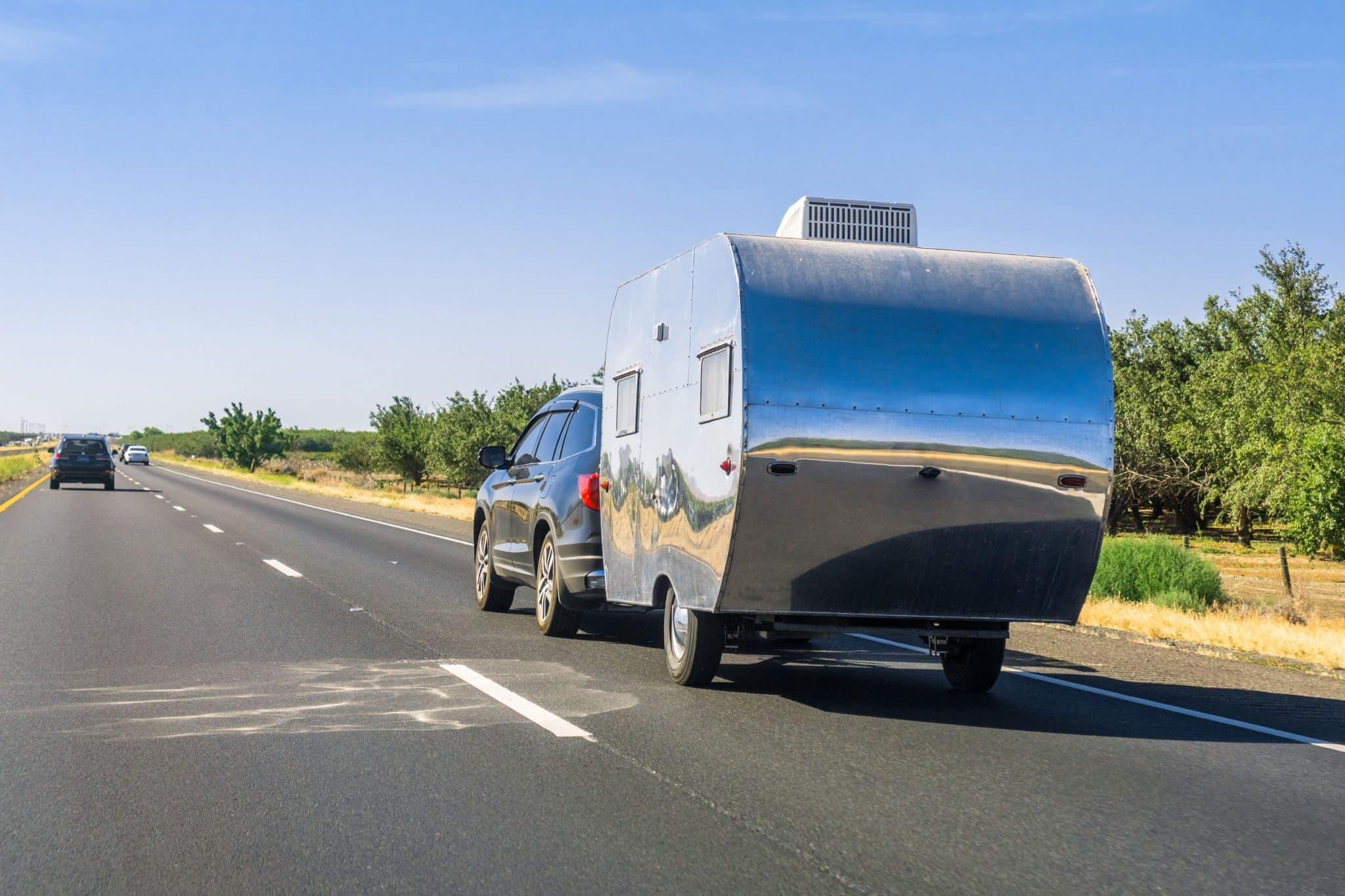 Car towing a trailer on the interstate, Michigan
