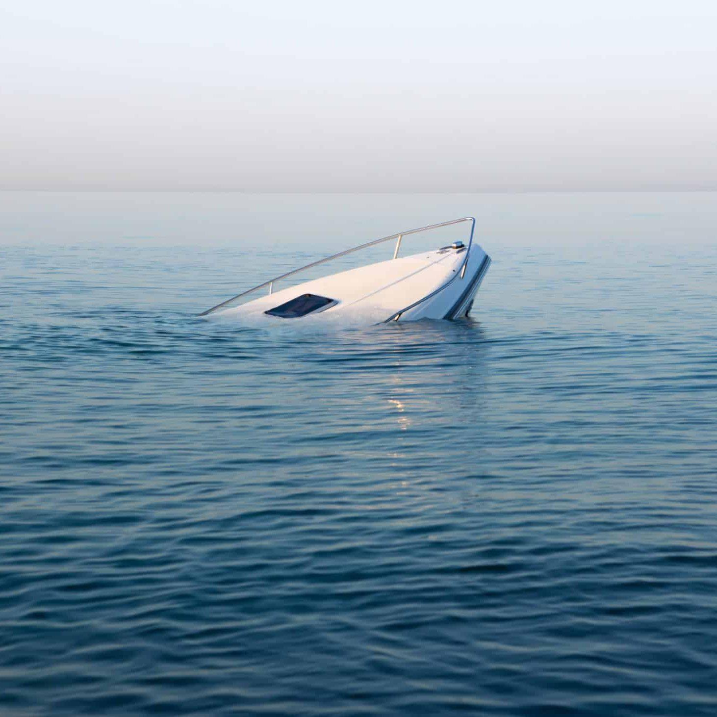 Modern white boat goes underwater after crash